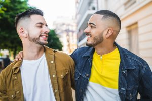 Image of two men looking lovingly at each other. This couple is representative of those that are hopeful to become parents and could get help from working with an infertility therapist in Chicago, IL. | 60305 | 60130 | 60402