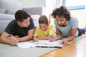 Image of two dads coloring with their son. This image depicts how marriage counseling in Chicago, IL can help parents prepare for their child. A couples therapist in Chicago, IL can help couples build a foundation before baby arrives.   60301   60302